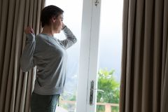 Woman stretching after wake-up in bedroom. At home Stock Images