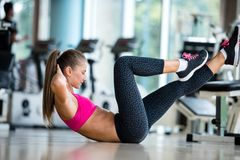 Woman stretching and warming up for her training at a gym Stock Image