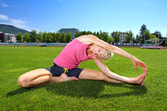 Woman  stretching after workout Royalty Free Stock Photo