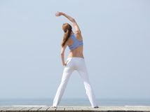 Woman stretching before workout at beach Royalty Free Stock Photography