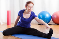 Woman stretching after workout Royalty Free Stock Images