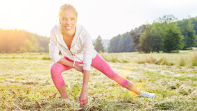 Woman stretching before workout Stock Photography