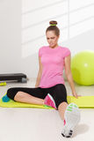 Woman stretching after workout Stock Photography