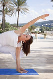 Woman stretching yoga stock images