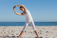 Woman stretching in yoga pose Royalty Free Stock Photos