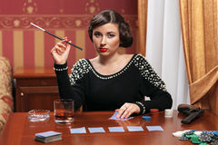 The woman in strict clothes in a retro style. Stock Photo