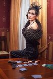 The woman in strict clothes in a retro style. Royalty Free Stock Photo