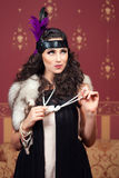 The woman in strict clothes in a retro style. Royalty Free Stock Images
