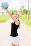 Woman strikes on volleyball ball Royalty Free Stock Photography