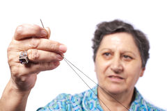 Woman with string and needle Stock Photography
