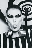Woman in striped costume shows tongue Royalty Free Stock Images