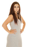 Woman in striped dress hands on hips serious Stock Photo