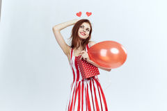 Woman in a striped dress, red stock photography