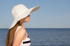 Woman in striped dress sitting on the beach Stock Photos