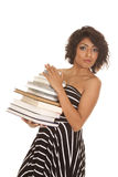 Woman striped dress stack of books looking serious Royalty Free Stock Image