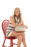 Woman striped dress stack books sit side Royalty Free Stock Photography