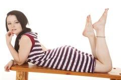 Woman striped purple dress lay stomach Royalty Free Stock Image