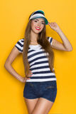 Woman In Striped Shirt And Sun Visor Stock Image