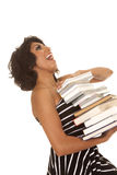 Woman striped stack of books head back laugh Royalty Free Stock Images