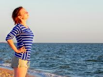 Woman in a striped t-shirt on the sea royalty free stock photo