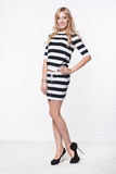 Woman in striped top and skirt Royalty Free Stock Images