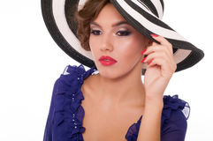 Woman in striped wide-brimmed hat Royalty Free Stock Photo