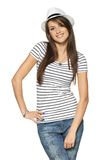 Woman in stripped t-shirt and white straw hat Stock Images