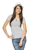 Woman in stripped t-shirt and white straw hat Royalty Free Stock Photo