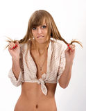 Woman in a stripy shirt holded in hands bad hair. Looking at camera Stock Photo