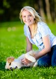 Woman strokes golden retriever Stock Photo
