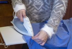 A woman Ironing a man`s shirt royalty free stock photo