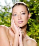 Woman stroking her fresh clean skin of face royalty free stock photography