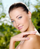 Woman stroking her fresh clean skin of face Royalty Free Stock Images