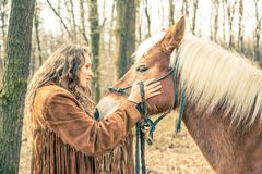Woman stroking horse Stock Photography