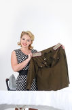 Woman stroking a military tunic. Blond woman stroking a military tunicn Stock Image
