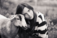 Woman is stroking a sheep Stock Photo