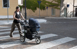 Woman with stroller Stock Photos