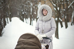 Woman with a stroller Stock Photo