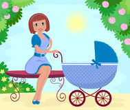 Woman with stroller. Young woman with baby stroller sitting on a bench in the park Stock Images