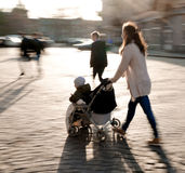 Woman with  stroller Royalty Free Stock Photos