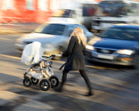 Woman with  stroller Royalty Free Stock Photo