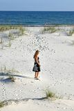 Woman Strolling on the Beach Stock Image