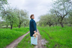 Woman strolling in blooming apple trees garden Stock Photography