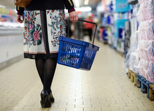 Woman strolling through the supermarket Royalty Free Stock Photo