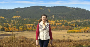 A Woman Strolls Through Fall Scenery in the San Francisco Mounta Royalty Free Stock Images