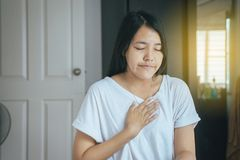 Woman with strong chest pain and hands touching her chest,Heart attack symptom. Asian woman with strong chest pain and hands touching her chest,Heart attack royalty free stock images