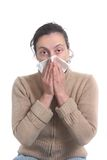 Woman with strong flu blowing her nose Royalty Free Stock Image