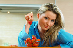 Woman with strowberry Stock Images