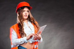 Woman structural engineer with tablet working. Royalty Free Stock Photo