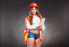 Woman structural engineer with tablet working. Royalty Free Stock Photos